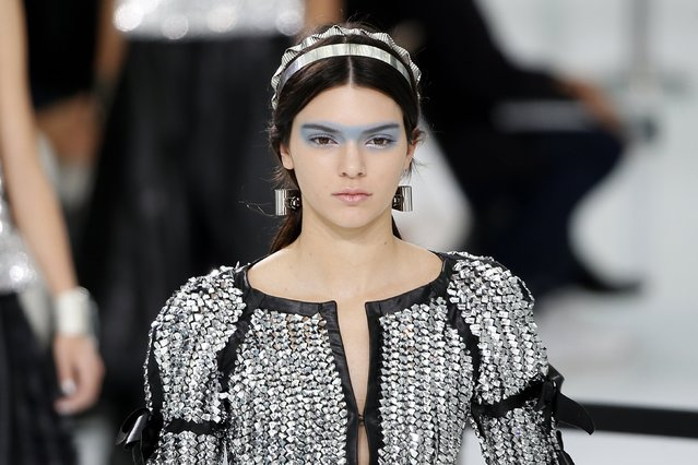 U.S. model Kendall Jenner presents a creation by German designer Karl Lagerfeld as part of his Spring/Summer 2016 women's ready-to-wear collection for French fashion house Chanel at the Grand Palais which is transformed into a Chanel airport during the Fashion Week in Paris, France, October 6, 2015. (Photo by Charles Platiau/Reuters)
