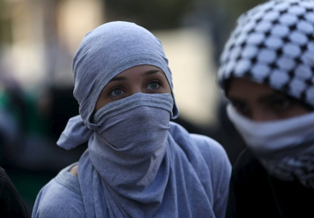 Masked Palestinian girls take position during clashes with Israeli troops near the Jewish settlement of Bet El, near the West Bank city of Ramallah October 8, 2015. (Photo by Mohamad Torokman/Reuters)
