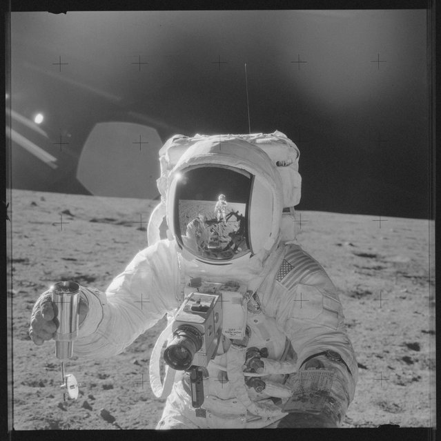 Astronaut Alan L. Bean holds a Special Environmental Sample Container filled with lunar soil collected during the Apollo 12 mission in this November 19, 1969 NASA handout photo. (Photo by Reuters/NASA)