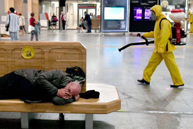 An employee of the Leader center for high risk rescue operations of the Russian Emergencies Ministry disinfects a waiting area at the Leningradsky railway station amid the COVID-19 coronavirus pandemic in Moscow, Russia on September 3, 2020. (Photo by Maxim Grigoryev/TASS via Getty Images)