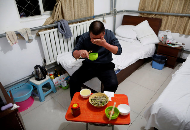 Yuan Yunping wipes sweat from his face as he eats dinner, which his son cooked for him, in his room at the accommodation where some patients and their family members stay while seeking medical treatment in Beijing, China, January 13, 2016. Yuan, who suffers from melanoma, came from Hebei Province to seek specialist treatment in Beijing. (Photo by Kim Kyung-Hoon/Reuters)