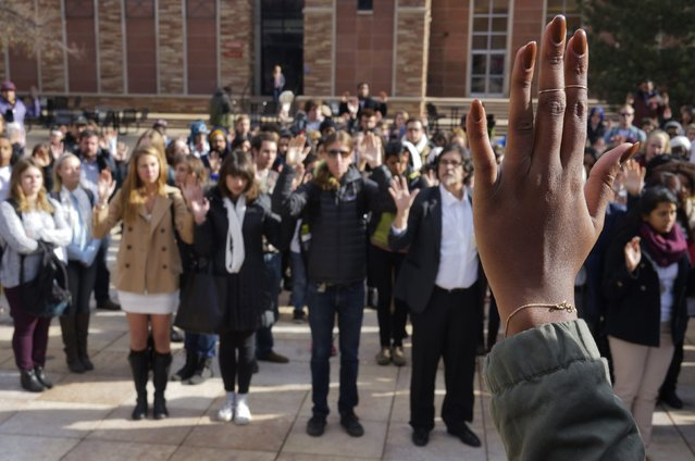 Students at the University of Colorado hold up their hands in support of protesters in Ferguson Missouri, during a demonstration, which was part of a national student walk-out, in Boulder, Colorado December 1, 2014. (Photo by Rick Wilking/Reuters)