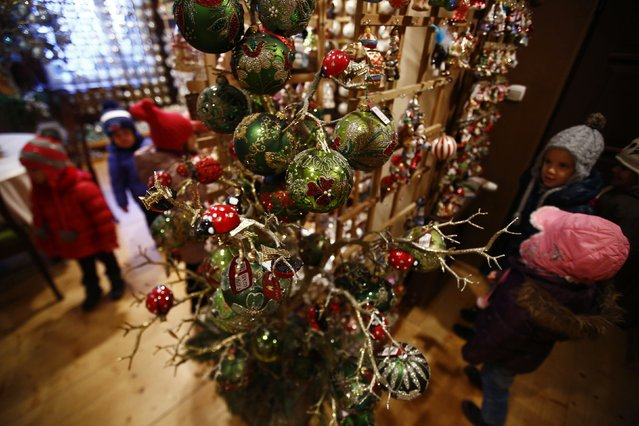 Children from Warsaw kindergarten visit the Silverado manufacture of hand-blown Christmas ornaments in the town of Jozefow outside Warsaw December 2, 2014. (Photo by Kacper Pempel/Reuters)