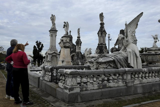 A couple watches the pantheon of the Marquesa de San Juan de Nieva, chosen as the best tomb sculpture of Spain in a Spanish magazine this week, in the municipal cemetery of La Carriona in Aviles, northern Spain, October 29, 2015. (Photo by Eloy Alonso/Reuters)