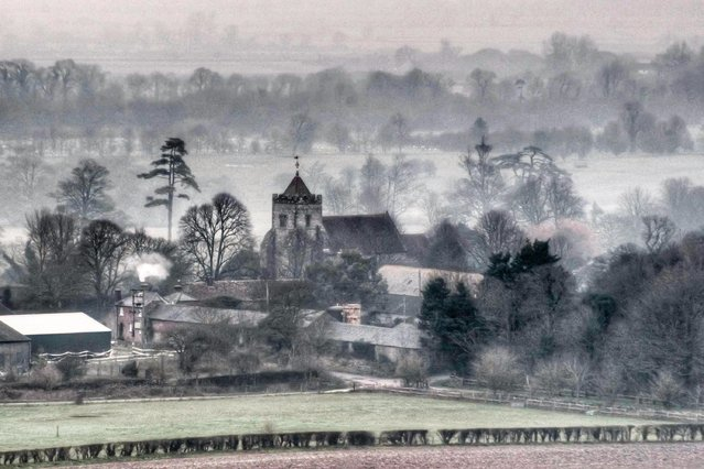 Fog, not firework smoke, shrouded Firle in East Sussex on the first morning of the new year on January 1, 2020. (Photo by David Burr/Alamy Live News)