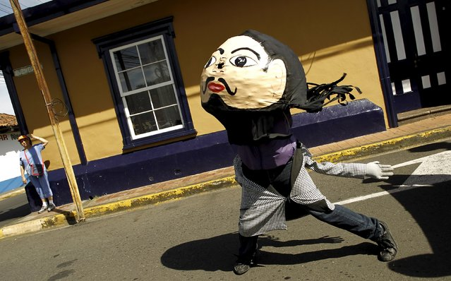 A boy performs a masked dance as he participates in a parade during the National Encounter of Mask festival in Barva de Heredia October 30, 2015. (Photo by Juan Carlos Ulate/Reuters)