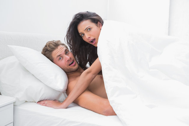 Couple surprised in bed, October 2013. Exact date unknown. (Photo by Alamy Stock Photo)