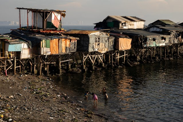 Children play beside shanties at Baseco Beach amid the coronavirus disease (COVID-19) outbreak in Manila, Philippines, November 10, 2020. (Photo by Eloisa Lopez/Reuters)