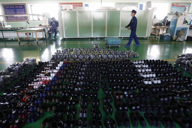Finished shoes are prepared for distribution at the Wonsan Leather Shoes Factory, where they manufacture handmade leather shoes in Wonsan, Kangwon Province, North Korea, on October 28, 2020. (Photo by Jon Chol Jin/AP Photo)
