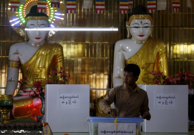 A man casts his ballot during the general election in Mandalay, Myanmar, November 8, 2015. (Photo by Olivia Harris/Reuters)