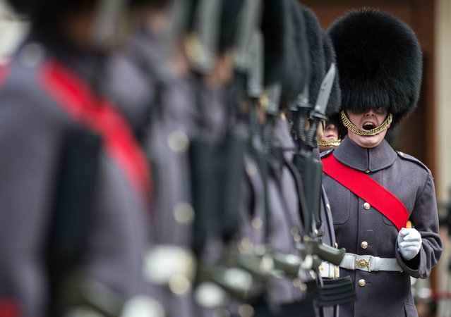 A handout picture made available by the British Ministry of Defense (MOD) shows the F Company Scots Guards providing an immaculate Guard of Honour in their winter ceremonial guard order of grey great coats and black bearskin caps to welcome the Indian Prime Minister Narendra Modi, in London, Britain, November 12, 2015. (Photo by Sergeant Rupert Frere/EPA)