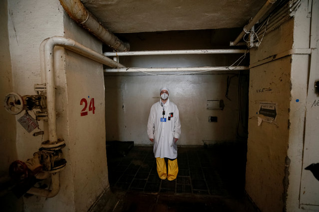 An employee walks through the corridor of the stopped third reactor at the Chernobyl nuclear power plant in Chernobyl, Ukraine April 20, 2018. (Photo by Gleb Garanich/Reuters)