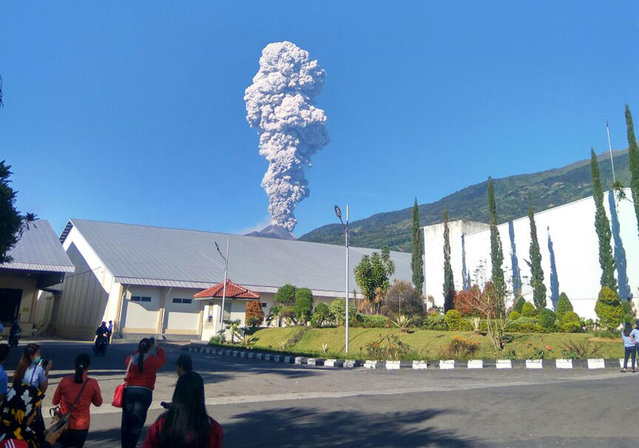 Mount Merapi spews volcanic materials from its crater as seen from Klaten, Central Java, Indonesia, Friday, May 11, 2018. Indonesia's most active volcano, Mount Merapi, has erupted, sending a column of volcanic materials as high as 5,500 meters (18,045 feet) into the sky. (Photo by Muhammad Amin/AP Photo)