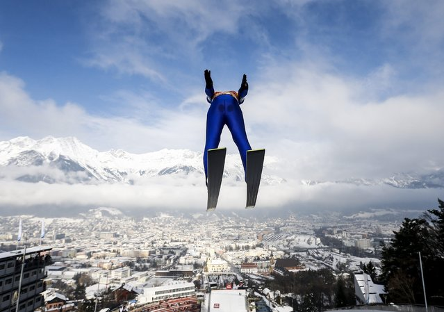 Michael Hayboeck from Austria soars through the air during the training for the third jumping of the 63rd four-hills Ski jumping tournament in Innsbruck, January 3, 2015. The prestigious four-hills tournament will end in Bischofshofen on January 6. (Photo by Dominic Ebenbichler/Reuters)