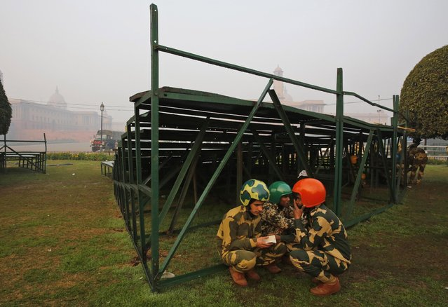 Soldiers of a Daredevils unit of the Indian Border Security Force take a break during rehearsals for the upcoming Republic Day parade in New Delhi, India, Thursday, January 14, 2015. (Photo by Manish Swarup/AP Photo)