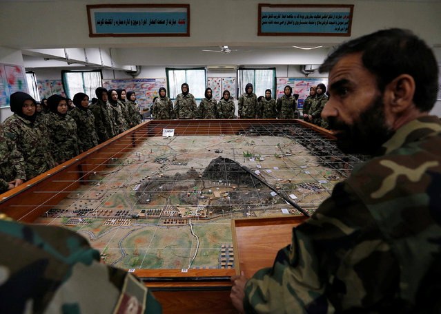 Afghan National Army (ANA) soldiers attend a lesson in a classroom at the Kabul Military Training Centre (KMTC) in Kabul, Afghanistan October 23, 2016. (Photo by Mohammad Ismail/Reuters)