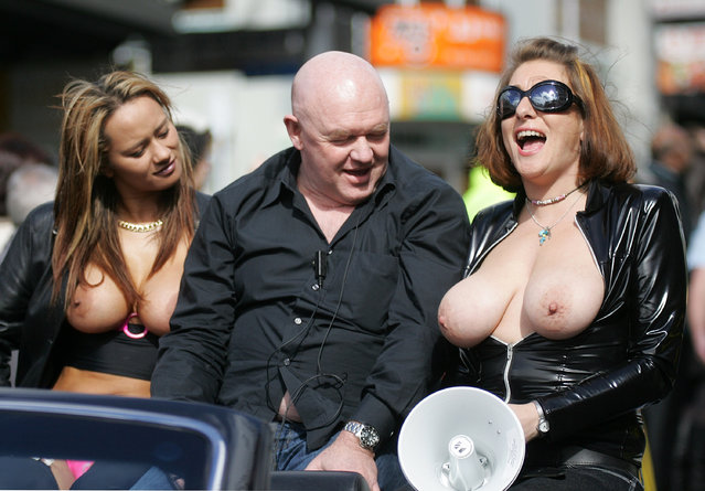 AUCKLAND, NEW ZEALAND - AUGUST 20:  (EDITORS NOTE: NUDITY) Boobs on Bikes parade organiser Steve Crow (C) rides down Queens Street during the annual `Boobs on Bikes' parade on Queens Street August 20, 2008 in Auckland, New Zealand.  (Photo by Tim Hales/Getty Images)