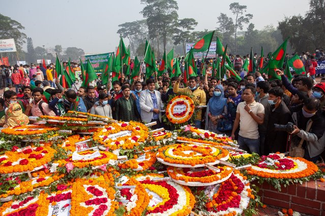 Bangladeshi People lay flowers at the national monument to pay tribute to the Martyrs during the Victory Day celebrations in Dhaka on December 16, 2020. Bangladesh is celebrating the 49th anniversary of its victory in the Liberation War as tributes poured in for the martyrs of the struggle for independence at the National Monument in Savar. (Photo by Nayan Kar/SOPA Images/LightRocket via Getty Images)