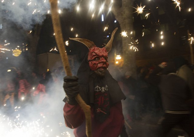"A reveller wearing a demon costume takes part in the traditional festival of ""Correfoc"" in Palma de Mallorca, on January 17, 2015. (Photo by Jaime Reina/AFP Photo)"