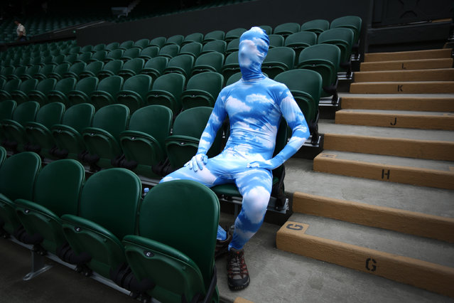 Tennis fan Chris Fava wears a blue sky body suit as he waits for the start of play on Centre Court on day seven of the Wimbledon Lawn Tennis Championships, on July 1, 2013. (Photo by Peter Macdiarmid/Getty Images)