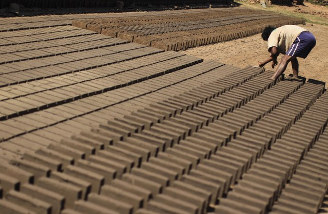 A worker works at a brick factory in Tixtla, on the outskirts of Chilpancingo, in the Guerrero state, January 26, 2015. (Photo by Jorge Dan Lopez/Reuters)