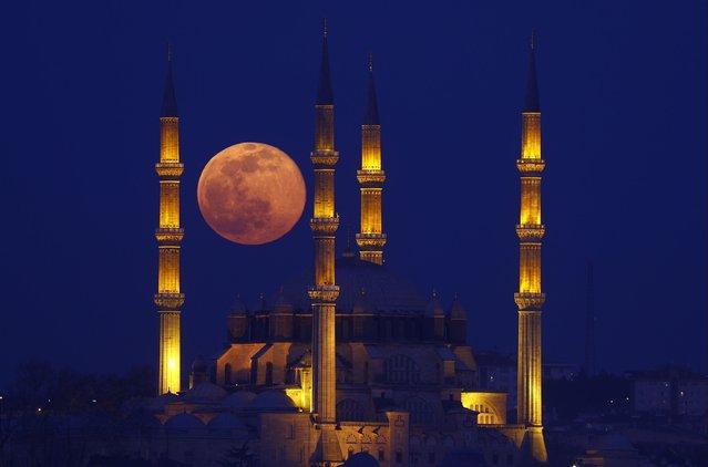 Full moon rises over Selimiye Mosque in Edirne, Turkey on February 27, 2021. (Photo by Gokhan Balci/Anadolu Agency via Getty Images)