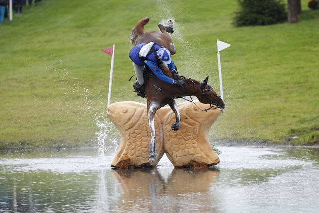 Russia's Mikhail Nastenko riding Reistag falls at the Lochan fence in the cross country event of FEI European Eventing Championship at Blair Castle, Scotland, Britain, September 12, 2015. (Photo by Russell Cheyne/Reuters)