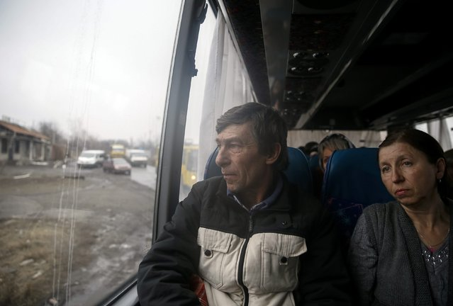 Local residents look through a bus window as they flee the conflict in Debaltseve, eastern Ukraine, February 6, 2015. (Photo by Gleb Garanich/Reuters)
