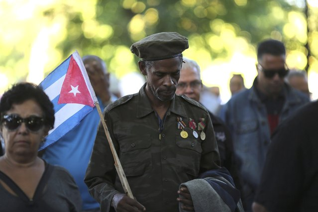 A man wearing medals on his uniform stands in line to pay tribute to Cuba's late President Fidel Castro in Revolution Square in Havana, Cuba, November 28, 2016. (Photo by Carlos Barria/Reuters)