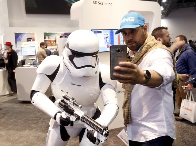 Carlos Cuevas of Puerto Rico takes a selfie with a life-sized Stormtrooper statue, from the Star Wars movies, at the 3D Systems booth during the 2016 CES trade show in Las Vegas, Nevada January 8, 2016. (Photo by Steve Marcus/Reuters)