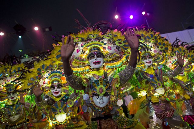 Members of Philippines's Bacolod City MassKara perform during a Chinese New Year evening parade at Hong Kong's Tsim Sha Tsui shopping district February 19, 2015. (Photo by Tyrone Siu/Reuters)
