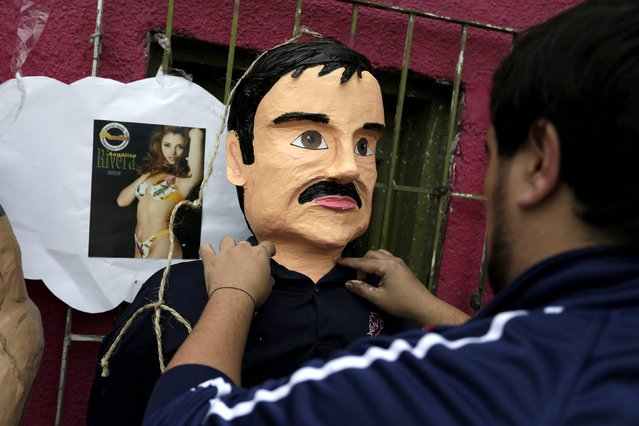"""An artisan arranges a pinata depicting the drug lord Joaquin """"El Chapo"""" Guzman outside his workshop in Reynosa, in Tamaulipas state, Mexico, January 13, 2016. (Photo by Daniel Becerril/Reuters)"""