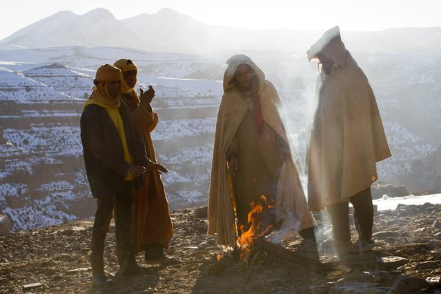 Villagers from Ait Sghir warm themselves a fire in Ait Sghir valley in Agoudal area in the High Atlas region of Morocco February 14, 2015. (Photo by Youssef Boudlal/Reuters)