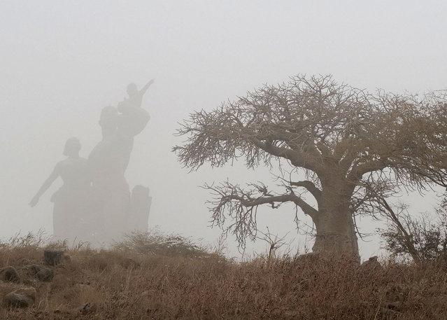Fog covers the African Renaissance Monument in Dakar, Senegal on February 17, 2021. (Photo by Zohra Bensemra/Reuters)