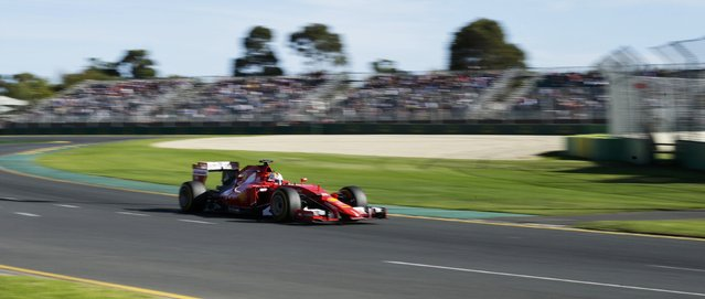 Ferrari Formula One driver Sebastian Vettel of Germany drives during the second practice session of the Australian F1 Grand Prix at the Albert Park circuit in Melbourne March 13, 2015.    REUTERS/Mark Dadswell
