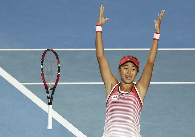 China's Zhang Shuai celebrates after winning her fourth round match against Madison Keys of the U.S. at the Australian Open tennis tournament at Melbourne Park, Australia, January 25, 2016. (Photo by Issei Kato/Reuters)