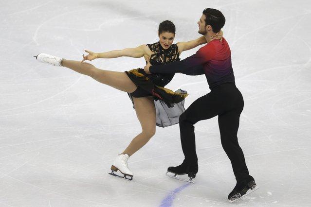 Laurence Fournier Beaudry and Nikolaj Sorensen of Denmark perform during the ice dance short dance program at the ISU European Figure Skating Championship in Bratislava, Slovakia, January 28, 2016. (Photo by David W. Cerny/Reuters)