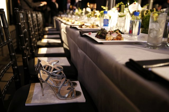 A pair of heels are left on a chair as a place holder at the 22nd Screen Actors Guild Awards in Los Angeles, California January 30, 2016. (Photo by Lucy Nicholson/Reuters)