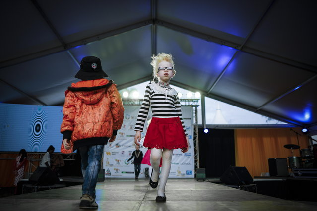 Seven-year-old albino girl Shirlyne walks on a runway as she rehearses for a fashion show prior to the Mr. & Miss Albinism East Africa contest in Nairobi, Kenya, 30 November 2018. (Photo by Dai Kurokawa/EPA/EFE)