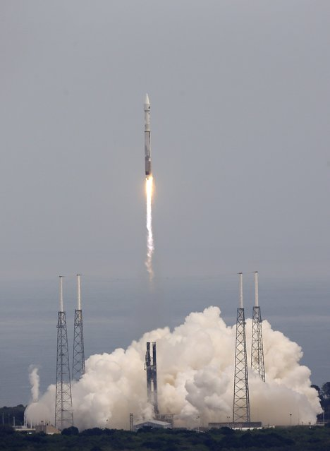 NASA's newest robotic explorer, Maven, atop a United Launch Alliance Atlas 5 rocket, lifts off from Cape Canaveral Air Force Station, Monday, Nov. 18, 2013, in Cape Canaveral, Fla. The spacecraft will orbit Mars and study the planet's upper atmosphere.(AP Photo/John Raoux)