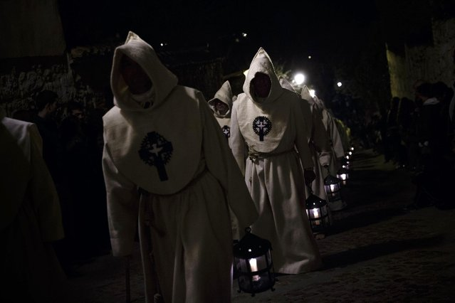 Penitents of the Santisimo Cristo del Espiritu Santo brotherhood take part in a Holy Week procession in Zamora, Spain, Friday, March 27, 2015. Hundreds of processions take place throughout Spain during the Easter Holy Week. (Photo by Daniel Ochoa de Olza/AP Photo)