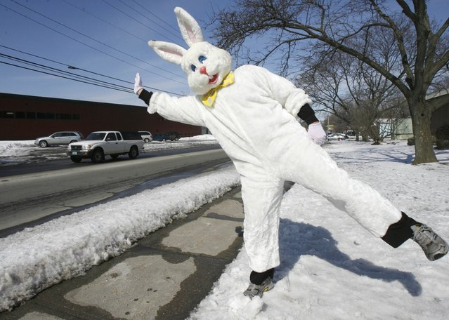 Adam Jarrett, dressed as the Easter Bunny, waves to passersby at Lake Champlain Chocolates in Burlington, Vt., Tuesday, March 11, 2008. Lake Champlain Chocolates is busy getting ready for the upcoming Easter season. (Photo by Toby Talbot/AP Photo)