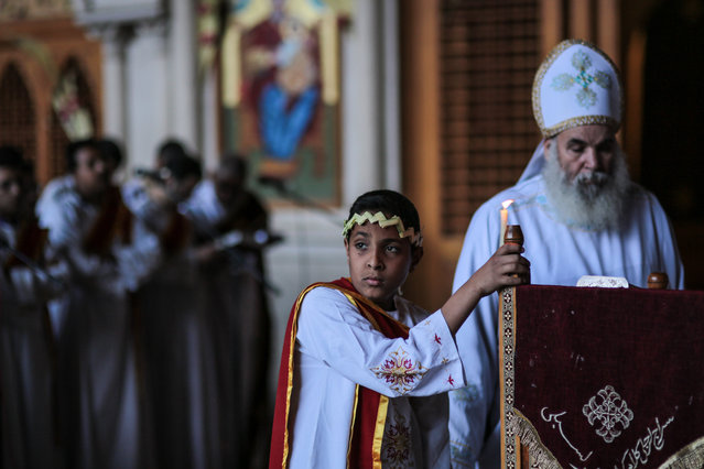 Egyptian Orthodox Christians celebrate Palm Sunday during a service at the Samaan el-Kharaz Church in the Mokattam district of Cairo, Egypt, Sunday, April 5, 2015. (Photo by Mosa'ab Elshamy/AP Photo)