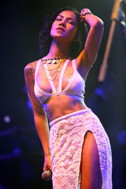 In this April 20, 2014 file photo, Jhene Aiko performs at the 2014 Coachella Music and Arts Festival in Indio, Calif. The festival, held in the Southern California desert on two consecutive weekends beginning Friday, April 10, 2015, is a style destination as much as a musical one –  this year more than ever. CFDA chief Steven Kolb said Coachella shapes today's fashion much like the Woodstock festival did in the early 1970s.  (Photo by Zach Cordner/Invision/AP Photo)