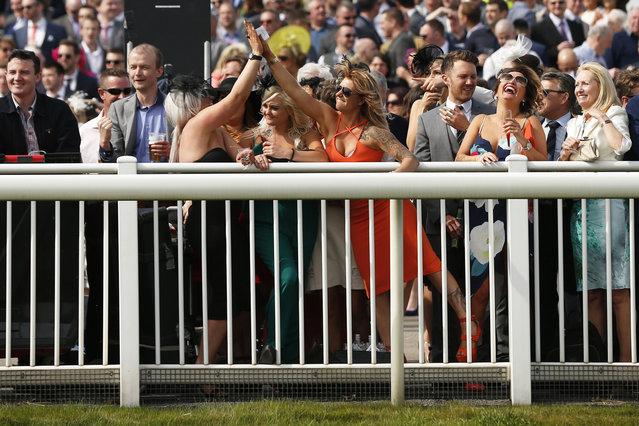 Horse Racing – Crabbie's Grand National Festival – Aintree Racecourse April 10, 2015: Racegoers celebrate after the 2.15 the E-Lites Top Novices' Hurdle Race. (Photo by Darren Staples/Reuters)