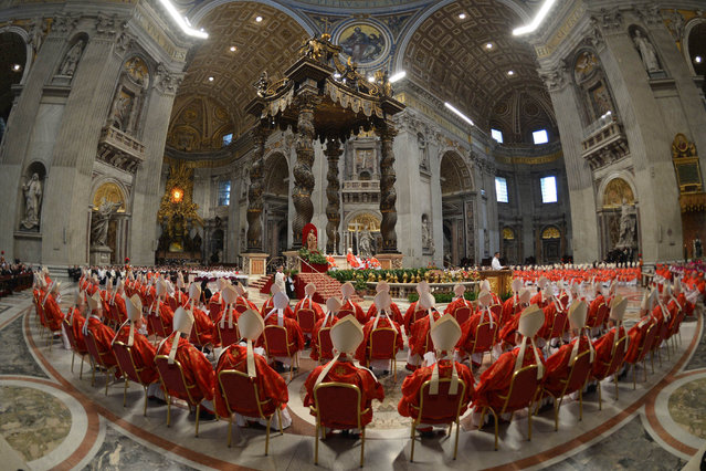Cardinals attend a mass at the St Peter's basilica before the start of the conclave on March 12, 2013 at the Vatican. (Photo by Gabriel Bouys/AFP Photo)