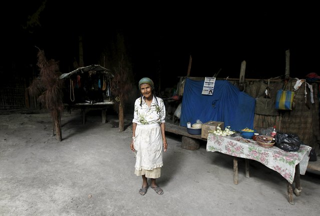 Francisca Gomez poses for a photograph next to her sleeping area at her home inside a cave where she has been living for the past 50 years, in the mountains on the outskirts of Chusmuy April 21, 2015. (Photo by Jorge Cabrera/Reuters)