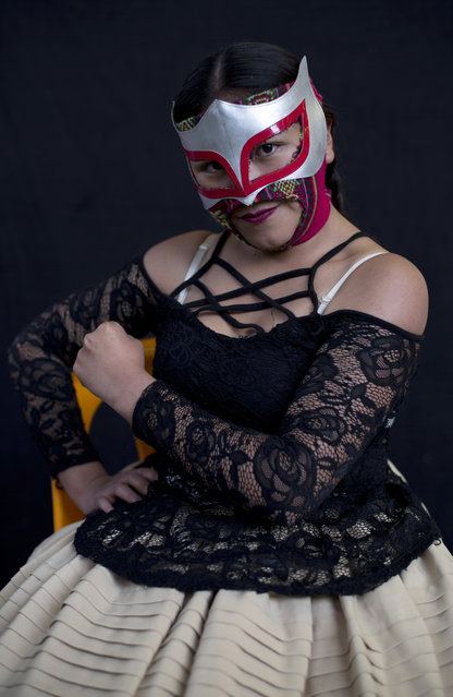 """Young cholita wrestler Lucero la Bonita strikes a pose for a portrait before fighting in the ring in El Alto, Bolivia, Sunday, February 10, 2019. """"I love to promote the culture of my country"""", said the 16-year-old fighter, one of 50 from a new generation of cholita fighters in training. (Photo by Juan Karita/AP Photo)"""