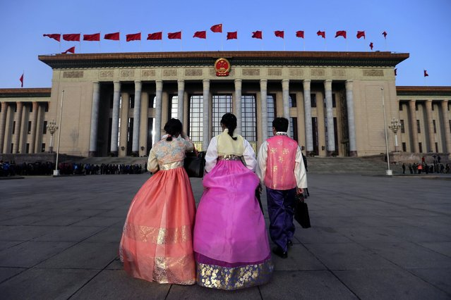 Three minority delegates wearing traditional costumes arrive before the opening of the fourth Session of the 12th National People's Congress (NPC) at the Great Hall of the People in Beijing, China, 05 March 2016. The NPC has over 3,000 delegates and is the world's largest parliament or legislative assembly though its function is largely as a formal seal of approval for the policies fixed by the leaders of the Chinese Communist Party. (Photo by Wu Hong/EPA)