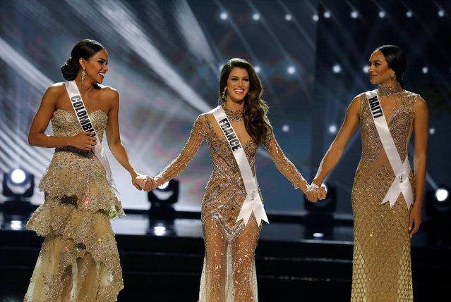 Miss France Iris Mittenaere (C) holds hands with other finalists Miss Haiti Jacque Pellisier (R) and Miss Colombia Andrea Tovar, shortly before Mittenaere won the 65th Miss Universe beauty pageant at the Mall of Asia Arena, in Pasay, Metro Manila, Philippines January 30, 2017. (Photo by Erik De Castro/Reuters)